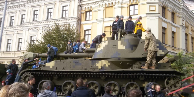 Children climbed atop military vehicles as President Poroshenko vowed that Ukraine would defend itself against all threats. (FoxNews.com)