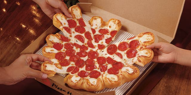 Pizza Hut is rolling out a super cheesy pizza as its way of saying happy holidays.