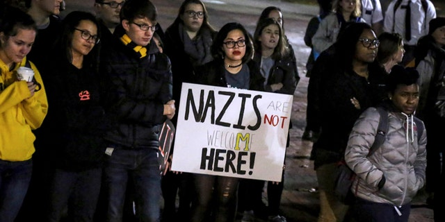 Protesters listen to speakers during a rally against Richard Spencer at the University of Michigan in Ann Arbor on Tuesday, Nov. 28, 2017.