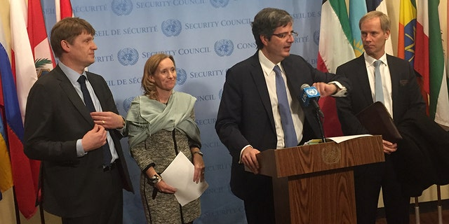 U.N. envoys from the U.S., U.K., France and Sweden announcing an informal Security Council meeting on the human rights crisis in Syria. U.S. diplomat Kelley Currie is second from left.