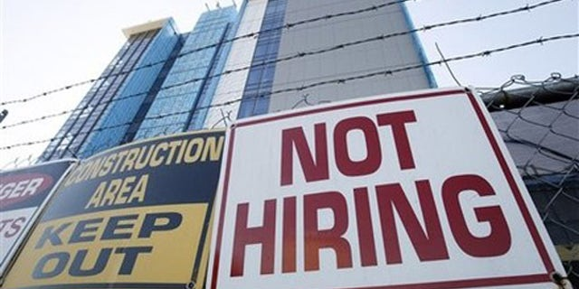 Thursday: A sign turning away potential job-seekers outside a construction site in New Orleans.  Employers added the most jobs in five months in October, but the unemployment rate remained at 9.6 percent and the construction industry posted no notable gains.