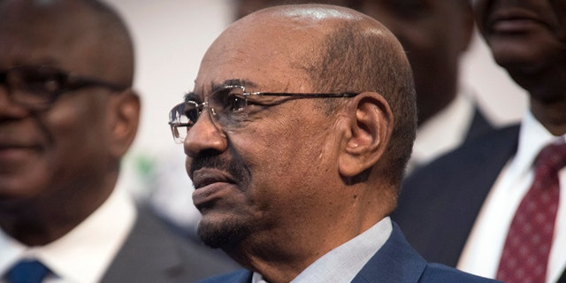 FILE - In this June 14, 2015, file photo, Sudanese President Omar al-Bashir attends a photo session at the African Union summit in Johannesburg.