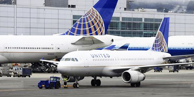 United has fired an employee who deployed an emergency slide.