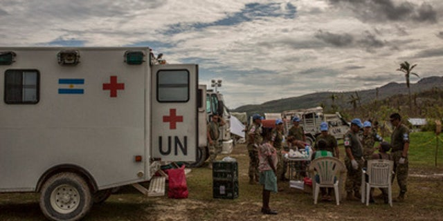 Argentinian peacekeepers with the United Nations Mission in Haiti (MINUSTAH) administer medical aid to residents of Les Cayes affected by Hurricane Matthew.