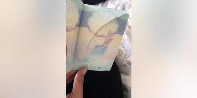 Authorities suggested the ripped page in her passport could be an attempt to hide a stamp from a suspicious country - and she was escorted off the premises.