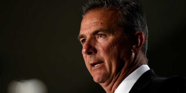 Ohio State head coach Urban Meyer was placed on paid leave as the school investigated the way he handled abuse allegations leveled by the ex-wife of former coach Zach Smith.
