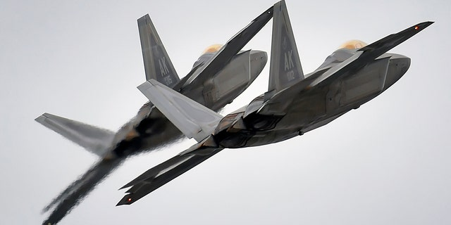 Two F-22 fighter jets from the 3rd Wing at Joint Base Elmendorf-Richardson, Alaska, conduct approach training, in this U.S. Air Force picture taken March 24, 2016.