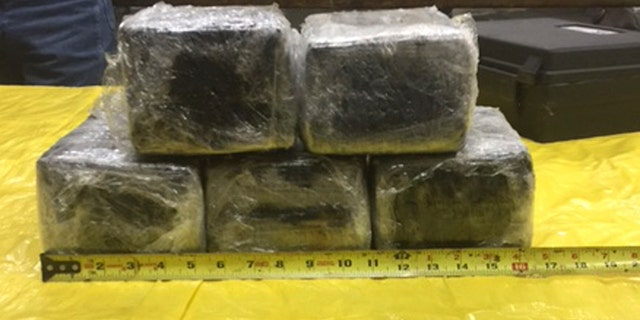 This photo provided by the Tulsa County Sheriff's Office shows some of the 31 pounds of cocaine that was accidentally discovered stashed in the nose of an American Airlines aircraft in Tulsa, Okla., Monday, Jan. 30, 2017. Tulsa County Sheriff's Office spokesman Justin Green says the plane arrived in Miami from Bogota, Colombia, on Sunday. (Tulsa County Sheriff's Office via AP)