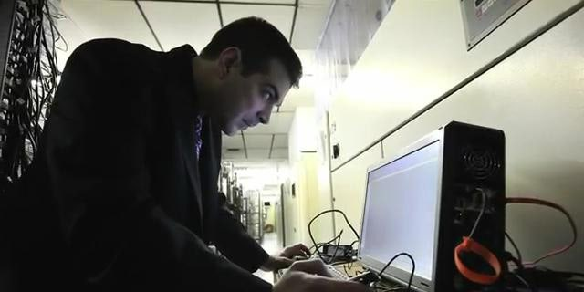 March 23, 2012: Digital forensic examiner Ashim Kapur disables a computer running the Zeus botnet in Scranton, PA.