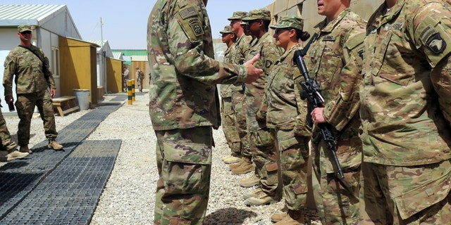 U.S. Army General John Nicholson, commander of Resolute Support forces and U.S. forces in Afghanistan, talks to U.S. soldiers during a transfer of authority ceremony at Shorab camp, in Helmand province, Afghanistan April 29, 2017. Picture taken April 29, 2017.