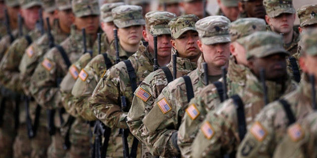 U.S. soldiers attend the inauguration ceremony of bilateral military training between U.S. and Polish troops in Zagan, Poland, January 30, 2017. REUTERS/Kacper Pempel - RTSY23N
