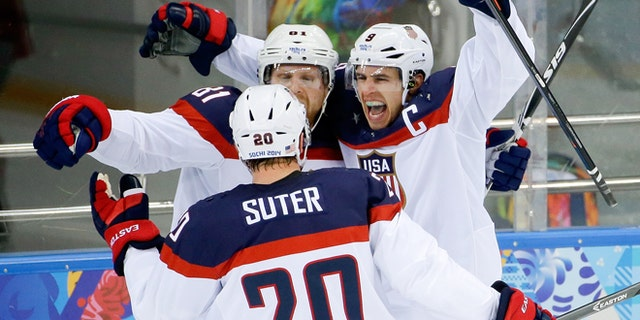 Feb. 19, 2014: USA forward Zach Parise (9) celebrates his goal against the Czech Republic with teammates Phil Kessel (81) and USA defenseman Ryan Suter during the second period of men's quarterfinal hockey game in Shayba Arena at the 2014 Winter Olympics in Sochi, Russia.
