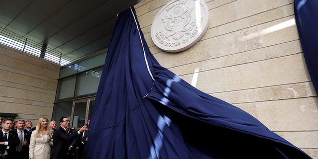 U.S. Treasury Secretary Steven Mnuchin and Ivanka Trump, left, among others, unveil the U.S. Embassy in Jerusalem.