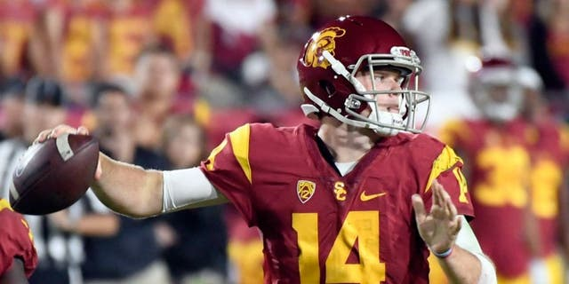 Oct 27, 2016; Los Angeles, CA, USA; USC Trojans quarterback Sam Darnold (14) passes against the California Golden Bears in the second quarter at Los Angeles Memorial Coliseum. Mandatory Credit: Richard Mackson-USA TODAY Sports
