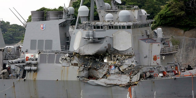 The damaged USS Fitzgerald is docked at the U.S. Naval base in Yokosuka.