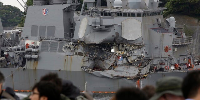 Journalists observing the damaged USS Fitzgerald at the U.S. Naval base in Yokosuka on June 18.