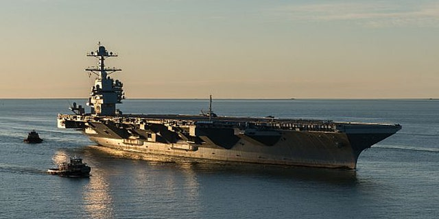 The aircraft carrier Pre-Commissioning Unit (PCU) Gerald R. Ford (CVN 78) pulls into Naval Station Norfolk for the first time on April 14, 2017. The first-of-class ship - the first new U.S. aircraft carrier design in 40 years - spent several days conducting builder's sea trails, a comprehensive test of many of the ship's key systems and technologies. (U.S. Navy photo by Matt Hildreth courtesy of Huntington Ingalls Industries/Released)