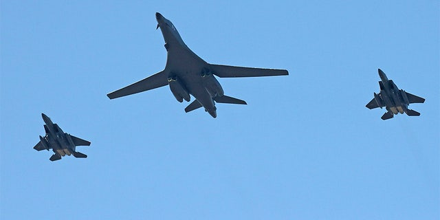 U.S. Air Force B-1B bomber, center, and two South Korean fighter jets F-15K fly over the Seoul Airport where a site for the 2017 Seoul International Aerospace and Defense Exhibition is taking place in Seongnam, South Korea, Saturday,