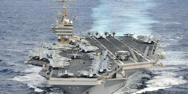 In this photo taken Dec. 16, 2011 and released by U.S. Navy, its aircraft carrier USS Abraham Lincoln (CVN 72) transits through the Pacific Ocean.