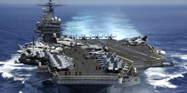 March 15, 2005: The nuclear powered aircraft carrier USS Carl Vinson (CVN 70) plows through the Indian Ocean as aircraft on its flight deck are prepared for flight operations.