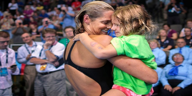 July 2, 2012: Dara Torres hugs her daughter Tessa Grace Torres-Hoffman after competing in the women's 50-meter freestyle final at the U.S. Olympic trials.