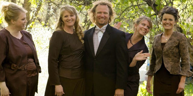 Kody Brown, center, poses with his wives, from left, Janelle, Christine, Meri, and Robyn in a promotional photo for TLC's reality TV show, 'Sister Wives.'