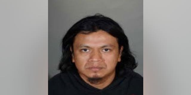 This photo released by the Los Angeles Police Department shows Ricardo Augusto Utuy.