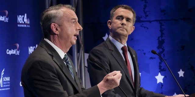 Sept. 19, 2017: Virginia gubernatorial candidates Republican Ed Gillespie, left, and Democratic Lt. Gov. Ralph Northam debate in McLean, Va. Hillary Clinton is planning to fundraise for Northam in the final stretch.