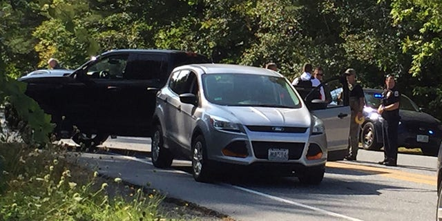 Police surround the suspect's vehicle near Dartmouth-Hitchcock Medical Center in Lebanon, N.H.