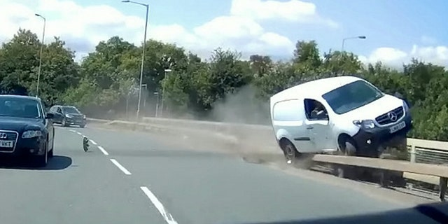 This video shows the see-it-to-believe-it moment when a van driver dices with death by grinding along the edge of a road bridge.  See MASONS story MNVAN.  The extraordinary footage of the white van grinding along the bridge rail Tony Hawk-style, going within inches of falling onto the dual carriageway below, happened in Burton-Upon-Trent, Staffordshire.  The footage shows the van being forced to grind along the road rail and then the edge of the bridge itself by a car in the inside lane, which appears to make a late break for the A38 slip road.  The footage was filmed by driving instructor Ian Stinchcombe, whose student was on her test at the time.