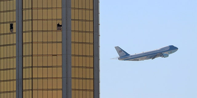 Oct. 4, 2017: Air Force One departs Las Vegas past the broken windows on the Mandalay Bay hotel, where Stephen Paddock carried out his mass shooting along the Las Vegas Strip.