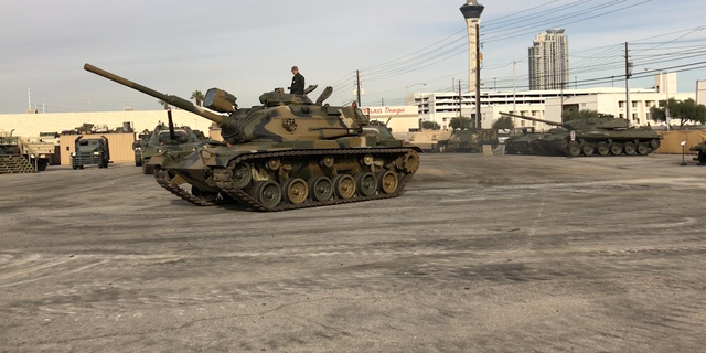 A tank drives in the lot of Battlefield Vegas