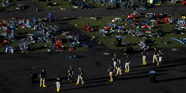 Investigators work at a festival grounds across the street from the Mandalay Bay Resort and Casino on Tuesday, Oct. 3, 2017, in Las Vegas. Authorities said Stephen Craig Paddock broke windows on the casino and began firing with a cache of weapons, killing dozens and injuring hundreds at the music festival on Sunday.