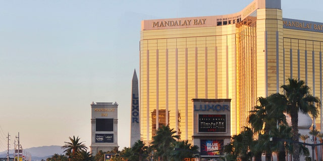 Police block a road on the Las Vegas Strip near the Mandalay Bay hotel and casino shortly after sunrise Monday, Oct. 2, 2017, in Las Vegas. A deadly shooting occurred late Sunday at a music festival on the Las Vegas Strip. (AP Photo/Ronda Churchill)