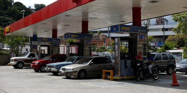 Cars repost fuel at a PDVSA gas station in Caracas, Venezuela, July 25, 2017.