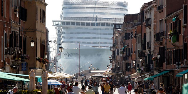 A cruise ship in Venice lagoon is seen looming over the city's streets in this 2017 photo.