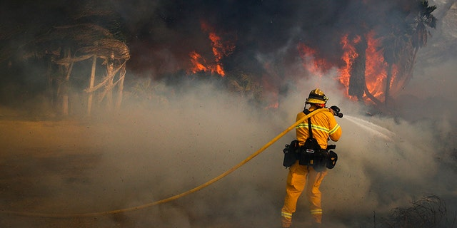 Dec. 7, 2017: A firefighter battles a wildfire at Faria State Beach in Ventura, Calif.