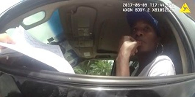 RETRANSMISSION TO CORRECT NAME TO POLICE OFFICER DAVID DOWLING - This photo taken from a body camera on June 9, 2017, shows tennis star Venus Williams listening to Palm Beach Gardens Police Officer David Dowling following a car crash in Palm Beach Gardens, Fla. The crash fatally injured an elderly man. Palm Beach Gardens police say the investigation remains open and no fault has been assigned. The estate of the man killed filed a wrongful death lawsuit against Williams on June 30. (Palm Beach Gardens Police Department via AP)