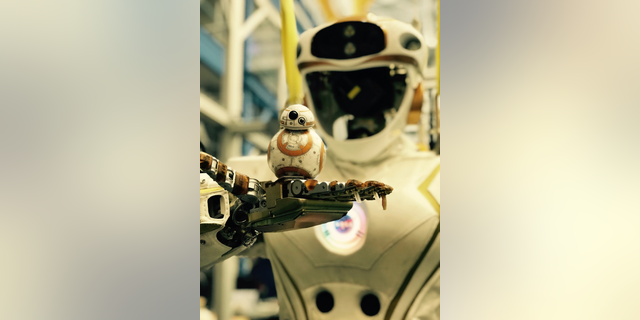 "NASA's Valkyrie robot holds a little ""Star Wars"" BB-8."