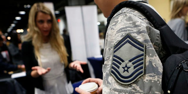 FILE: January 10, 2014: An Air Force sergeant talks with a recruiter at the Hiring Our Heroes job fair in Washington, D.C.