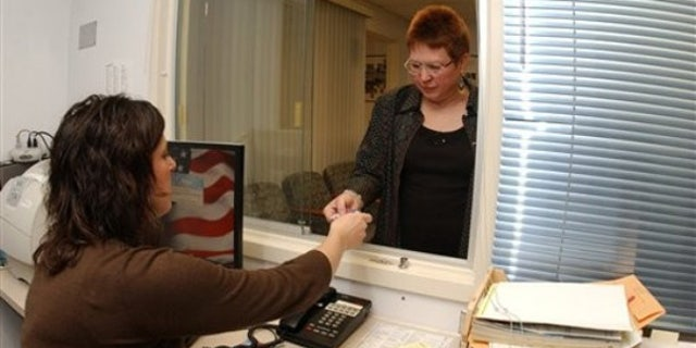 U.S. Air Force veteran Wendy Haylor, of Piedmont, W.Va., checks in with Amy Theriault, Women Veterans Program Manager at the Women Veterans Health Clinic Friday, Nov. 13, 2009, at the Veterans Affairs Medical Center in Martinsburg, W. Va. (AP Photo/Ron Agnir)