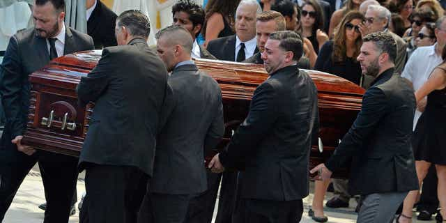 Mourners carry the casket of Karina Vetrano from St. Helen's Church after her funeral in August 2016.