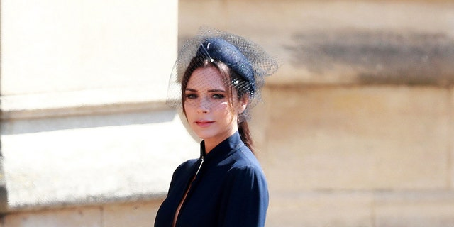 Beckham donned her own design to the royal wedding and joked about being pregnant during Prince William and Kate Middleton's 2011 wedding.