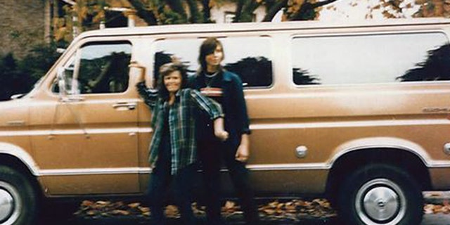 Tanya Van Cuylenborg and Jay Cook with the van they drove to the United States, a bronze 1977 Ford Club wagon.