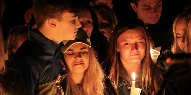 People attend a vigil for the victims of a fatal shooting at Marshall County High School, Jan. 25, 2018, at Mike Miller County Park in Benton, Ky.