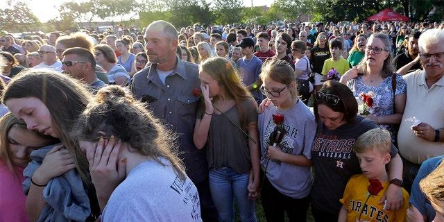 Mourners gather during a prayer vigil following a shooting at Santa Fe High School in Santa Fe, Texas on Friday.