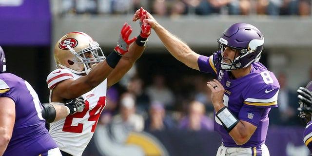 Minnesota Vikings quarterback Kirk Cousins (8) throws a pass over San Francisco 49ers defensive back K'Waun Williams (24) during the first half of an NFL football game, Sunday, Sept. 9, 2018, in Minneapolis. (AP Photo/Bruce Kluckhohn)