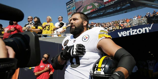 Pittsburgh Steelers offensive tackle and former Army Ranger Alejandro Villanueva (78) stands outside the tunnel alone during the National Anthem before an NFL game against the Chicago Bears Sunday, Sept. 24 in Chicago.
