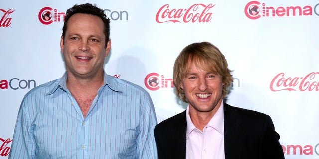 Actors Vince Vaughn (L) and Owen Wilson, recipients of the Comedy Duo of the Year Award, arrive at the CinemaCon awards ceremony at Caesars Palace in Las Vegas, Nevada April 18, 2013. CinemaCon is the official convention of the National Association of Theatre Owners. REUTERS/Steve Marcus (UNITED STATES - Tags: ENTERTAINMENT) - RTXYRS1