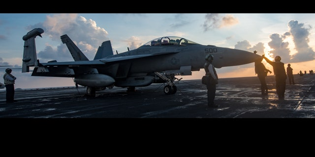 Sailors assigned to the Electronic Attack Squadron (VAQ) 136 'Gauntlets' prepare an EA-18G Growler for flight on the USS Carl Vinson (CVN 70).